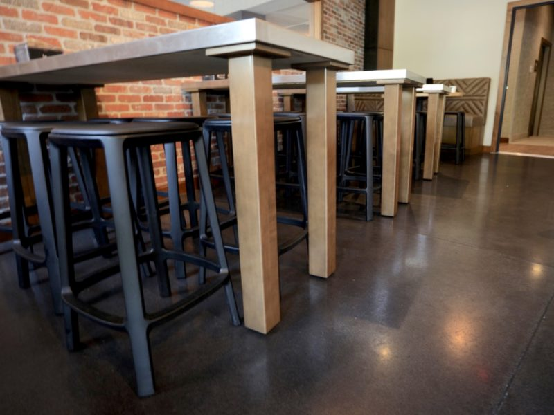 Tucked in stools with a brick wall