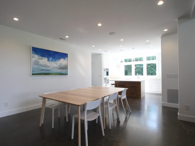 Open concept dining room and kitchen with polished concrete floor