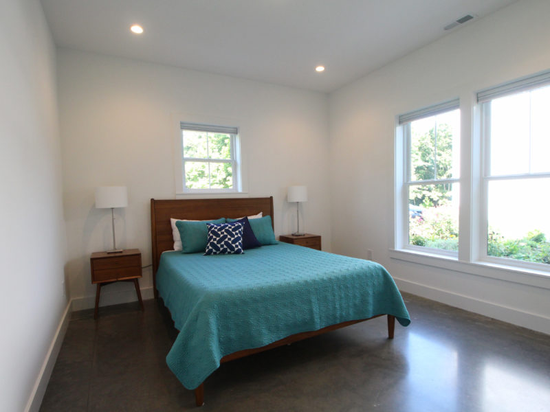 Bedroom with a polished concrete floor