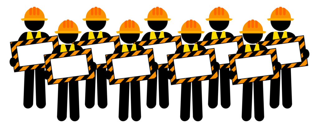 Nine construction human figures holding blank caution signs standing in two lines.