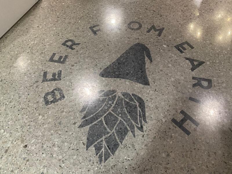 Penetrating dye logo on a polished concrete floor