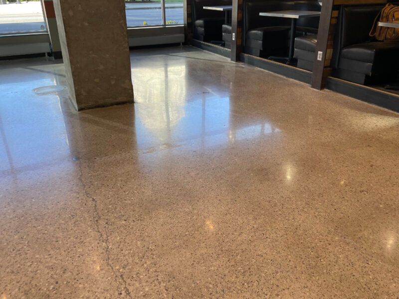 Polished concrete floor in an empty room with support beam